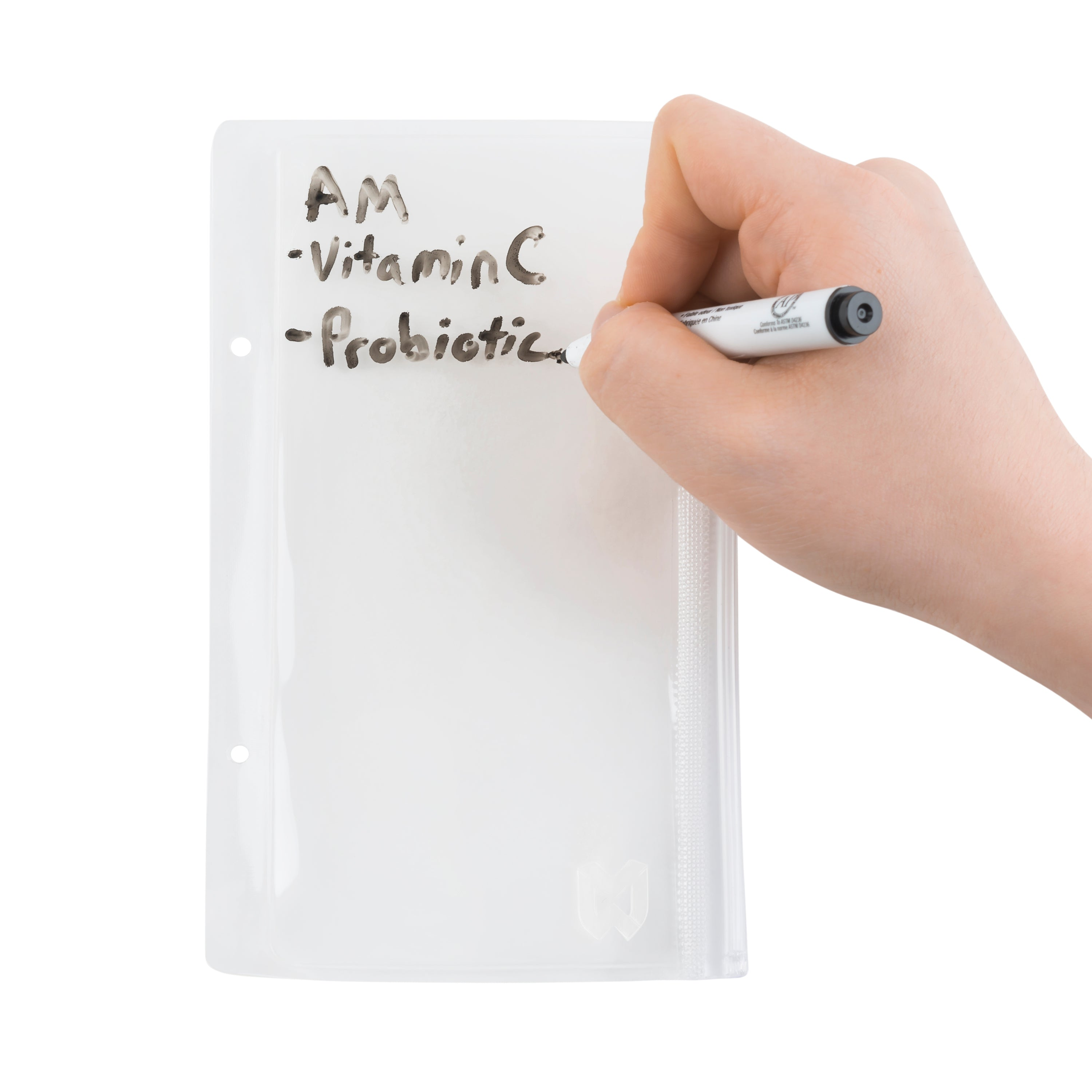 Writing on the medication sleeves of the Mighty MedPlanner, a portable medication organizer