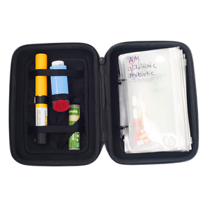 The Mighty MedPlanner, a portable medication organizer, opened and filled with medication