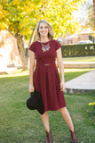 Burgundy Modest Dress Comfortable modest knee length dress with sleeves with an gold adornment