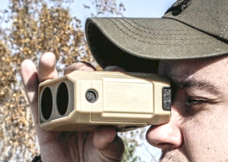 Newcon LRM-3500M Laser Range Finder Monocular, In Use, Tan Sleeve shown