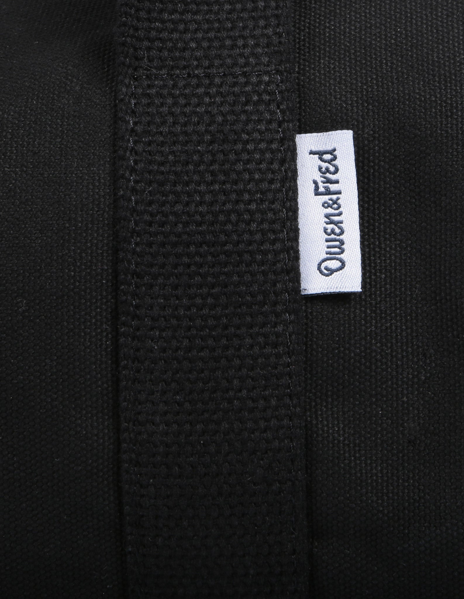 Detail of Black Work Hard, Play Hard canvas duffel bag by Owen & Fred
