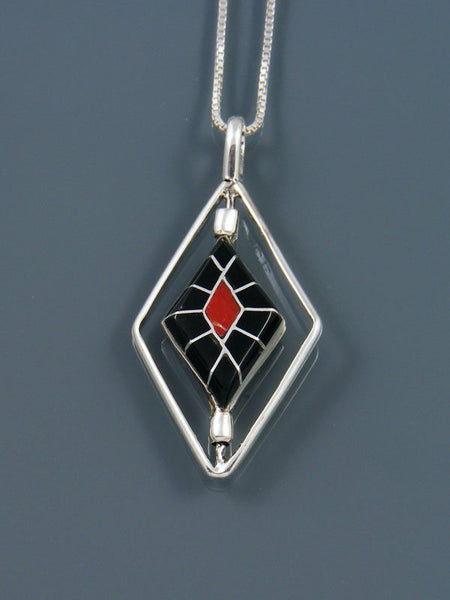 Coral and Onyx Inlay Sterling Silver Zuni Spinner Pendant