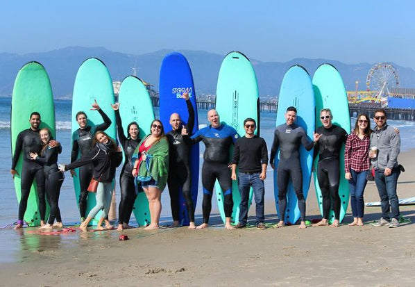 People learning how to surf at Go Surf LA Surf School