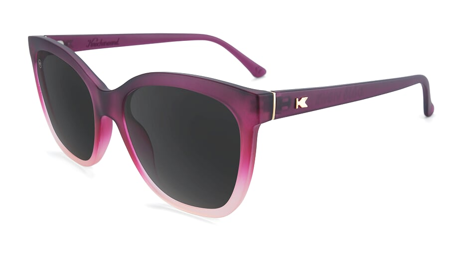 Translucent dark purple cat eye sunglasses with black lenses