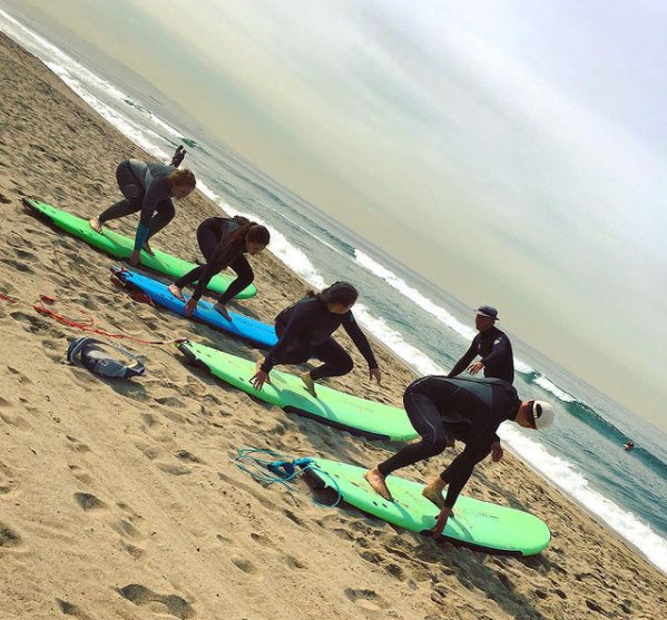 People learning to surf at the beach - Learn To Surf LA