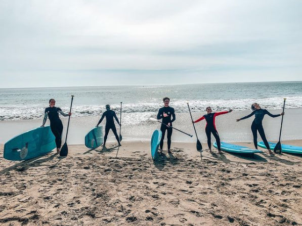 People learning to stand-up paddle board - Malibu Surf Coach