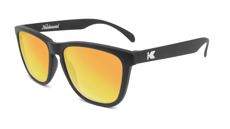 Matte black sunglasses with orange mirrored lenses
