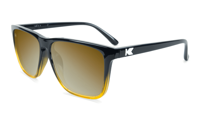 Glossy black sunglasses with gold lenses