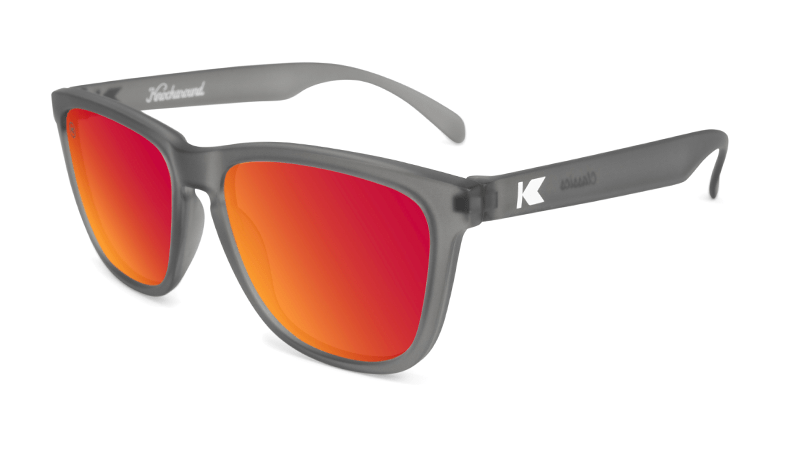 Frosted grey translucent sunglasses with red square lenses