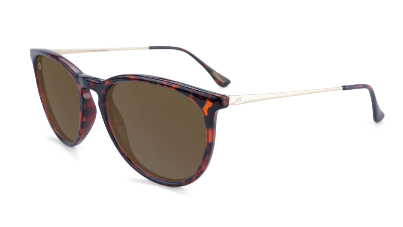 Tortoise shell sunglasses with gold arms and amber lenses