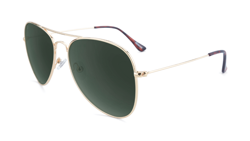 Gold aviators with green lenses