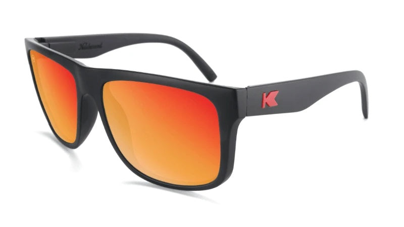 Large black sunglasses with square red lenses