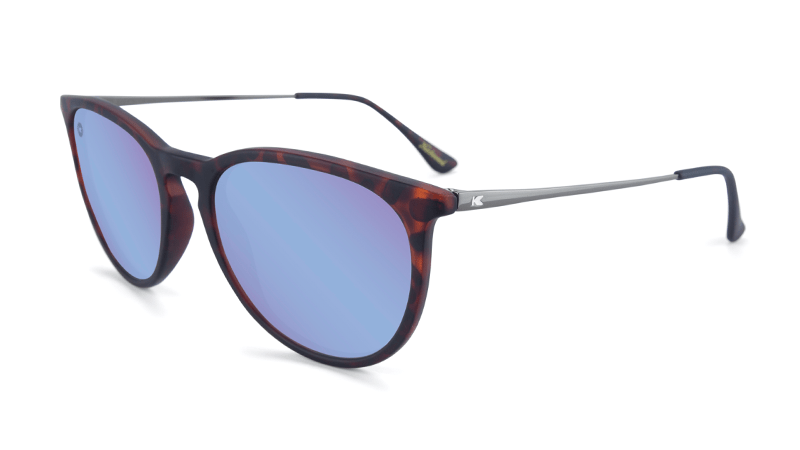 Matte tortoise sunglasses with round mirrored blue lenses