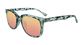 Glossy slate tortoise shell sunglasses with peach lenses