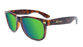 Glossy tortoise shell sunglasses with green lenses