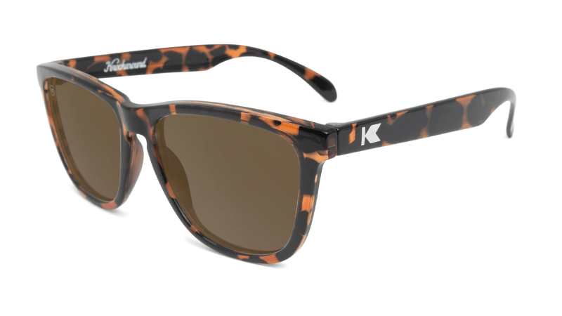 Glossy tortoise shell sunglasses with amber lenses