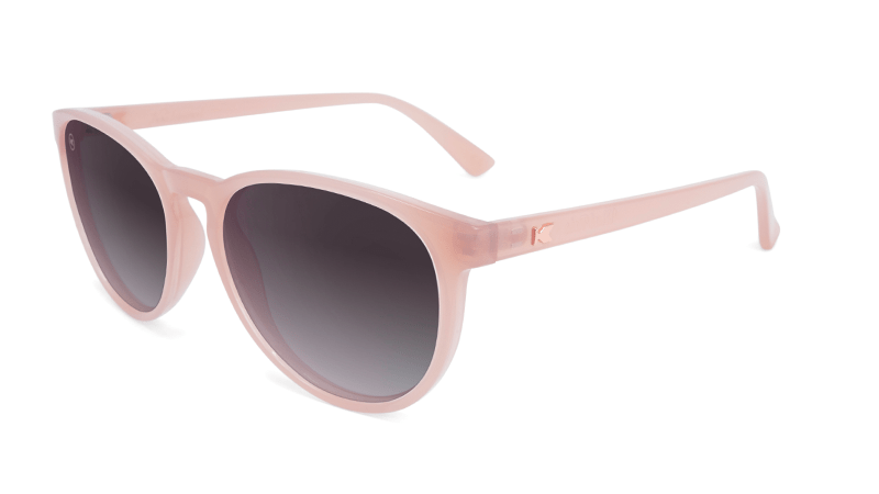 Blush pink sunglasses with round black lenses