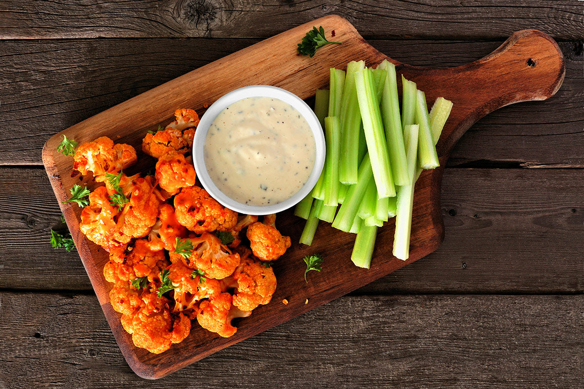 Cauliflower buffalo wings with celery and ranch dip