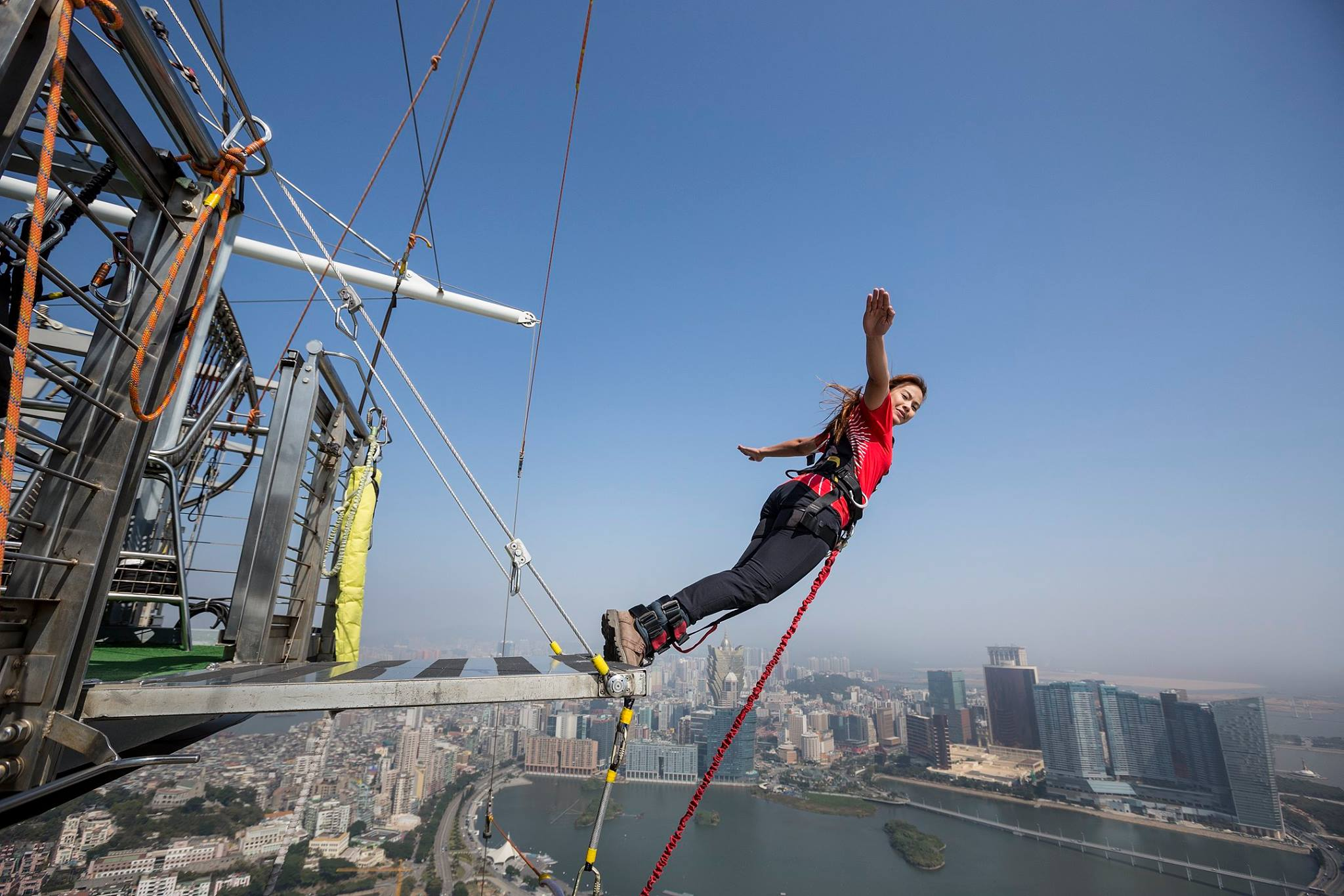 Bungee jumping off of the Macau Tower in China