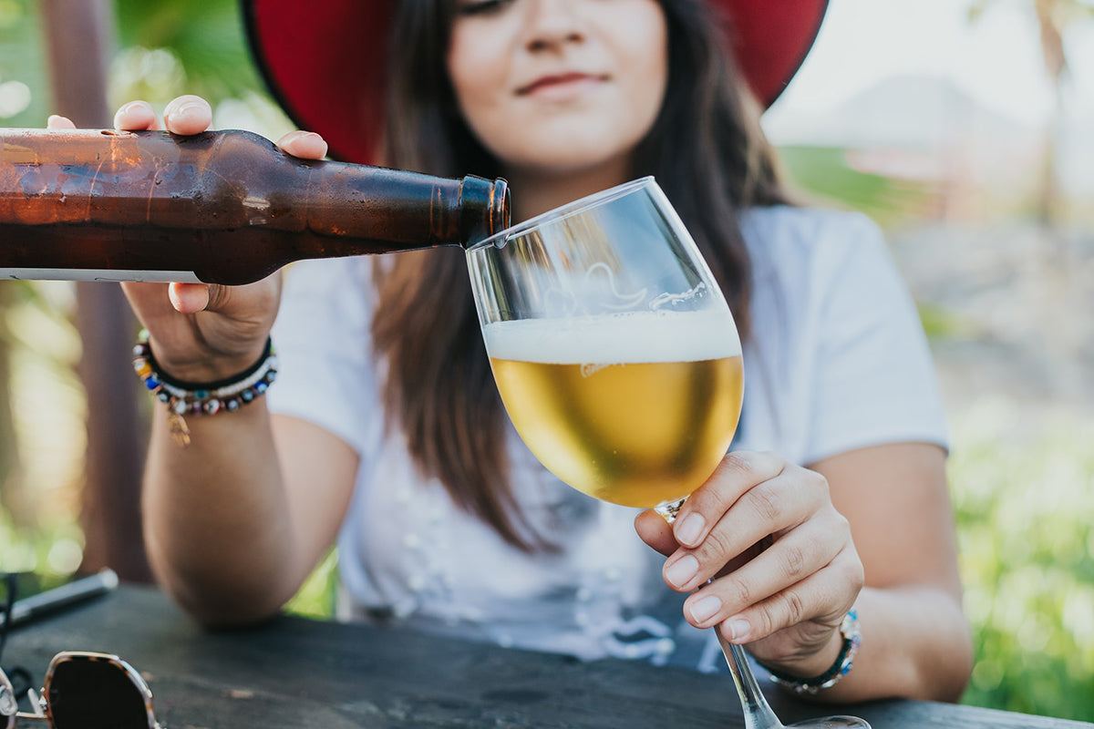 Woman pouring beer into a glass