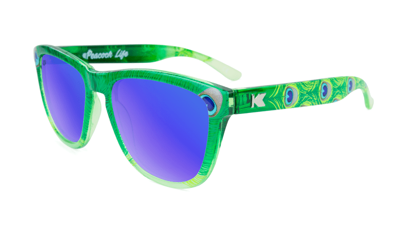 peacock print sunglasses with blue lenses