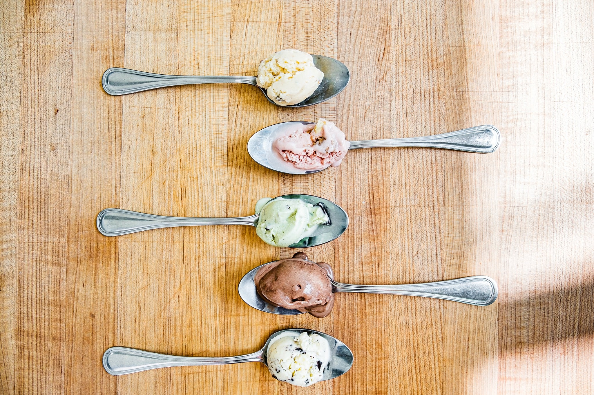 Spoons with different ice cream flavors from Mr. Trustee Creamery