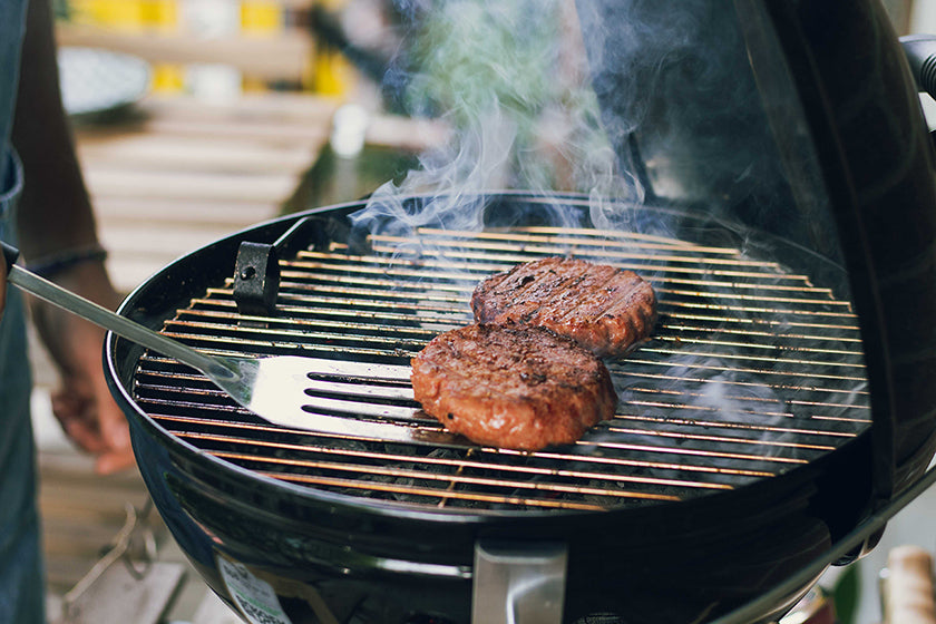 Flipping burgers on the grill