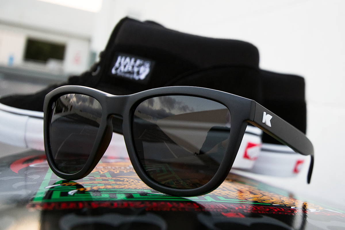 Vans Half Cab skate shoes and Knockaround matte black polarized sunglasses