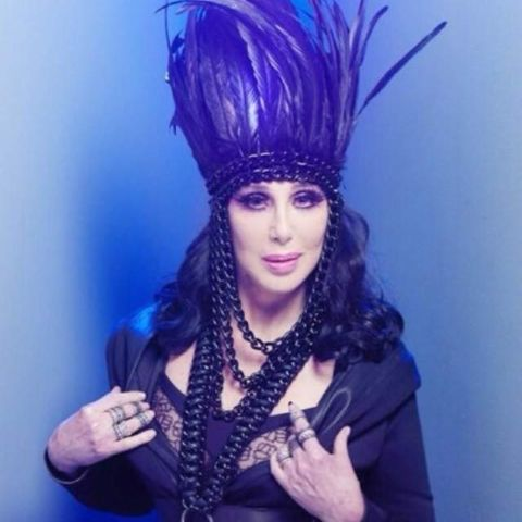 Cher: black feather headdress and harness, Dressed 2 Kill tourbook, promo, and merch