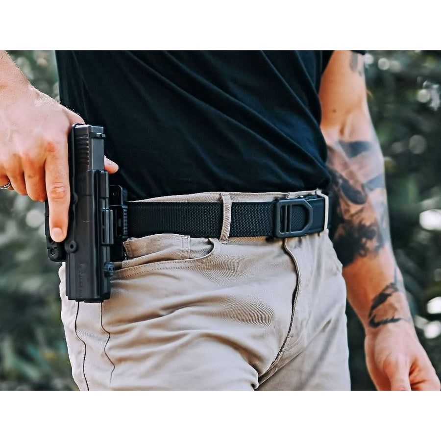 KORE X5 Gun Buckle with Tan Reinforced Tactical Belt. Track style gun belts provide a perfect fit to secure your holster and firearm. By Kore Essentials