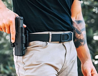 X5 Gun Buckle & Black Reinforced Tactical Belt. Track style gun belts provide a perfect fit to secure your holster and firearm. By Kore Essentials