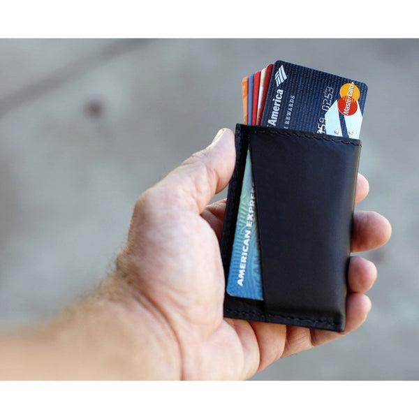 Kore Slim Wallet with Carbon Fiber Money Clip. Full-Grain leather skinny wallet with RFID protection.