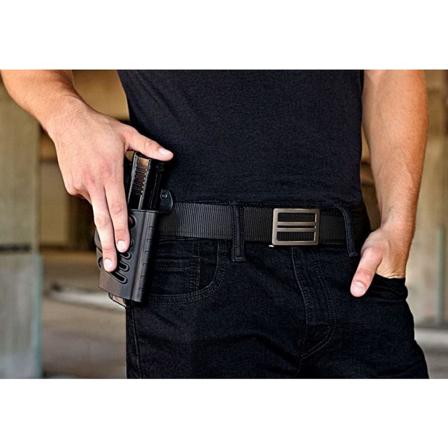 Kore X1 EDC Gun Buckle with Black Tactical gun belt. Kore ratchet style buckle with no holes track belt.