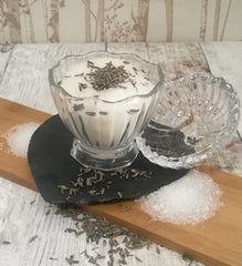 baths salts in a glass jar with scattered lavender