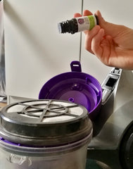 Lime essential oil being used in a vacuum