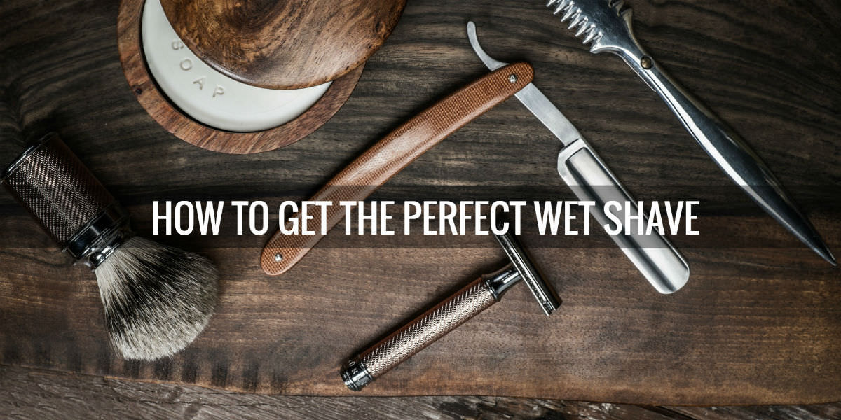 """classic shaving tools on a wooden background with caption: """"How to get the perfect wet shave"""""""