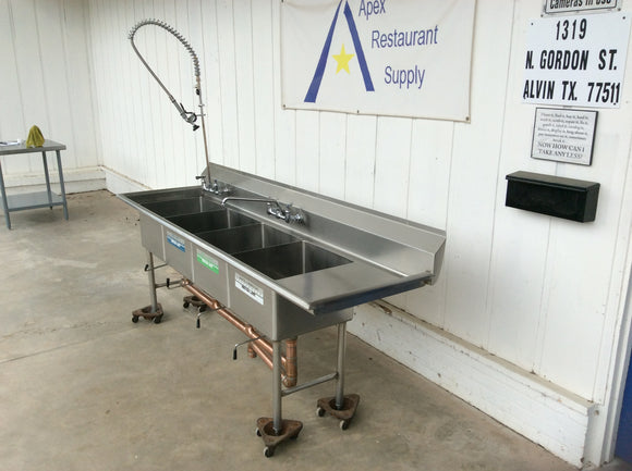 Three Compartment Stainless Steel Sink with Pull out Sprayer, drainboards, and backsplash board.