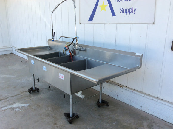 Three compartment sink with drainboards, drain levers, pull out sprayer, sanitizer dispenser and drainboards. Stainless Steel, commercial