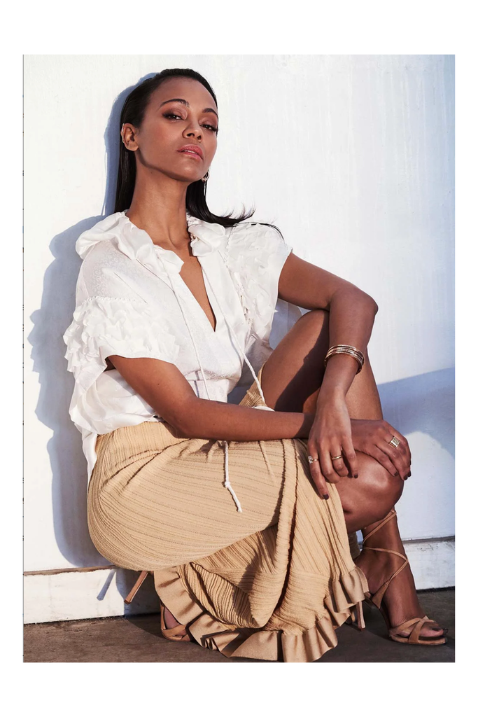 Zoe Saldana wearing the Shahla Karimi Emerald Belt Ring and Marquise Top of Ear Cuff.