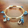 Horseshoe Blue Topaz Bangle Bracelet, 14k gold
