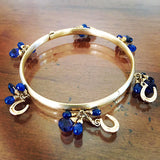 Horseshoe Blue Sapphire Bangle Bracelet, 14k gold