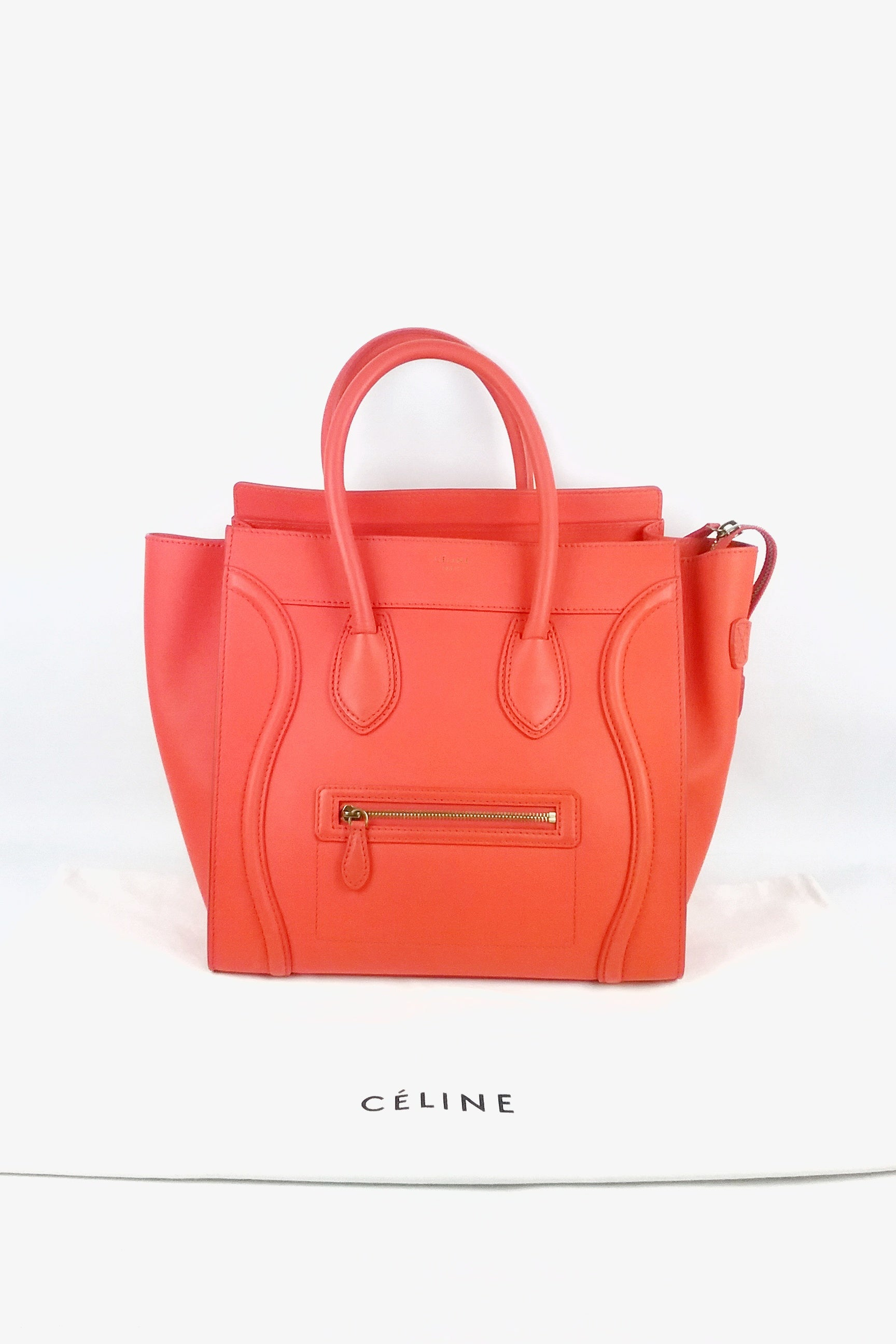 Orange drummed leather mini luggage