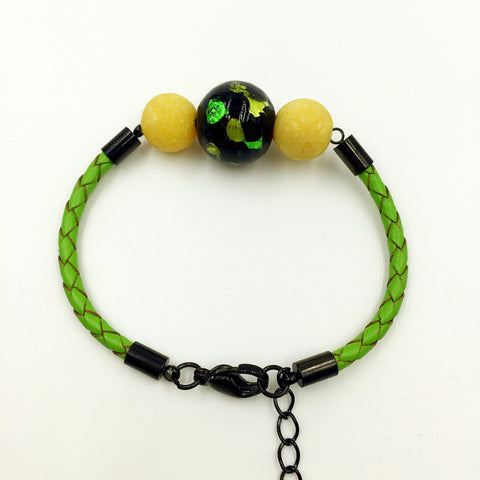 Yellow Macaron Florescent Black Bead on Green Leather