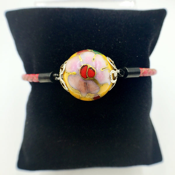 Single Golden Yellow Bead on Red Leather