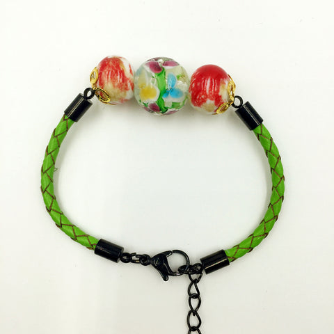Triple Flower Clear and Ceramic Beads on Green Leather