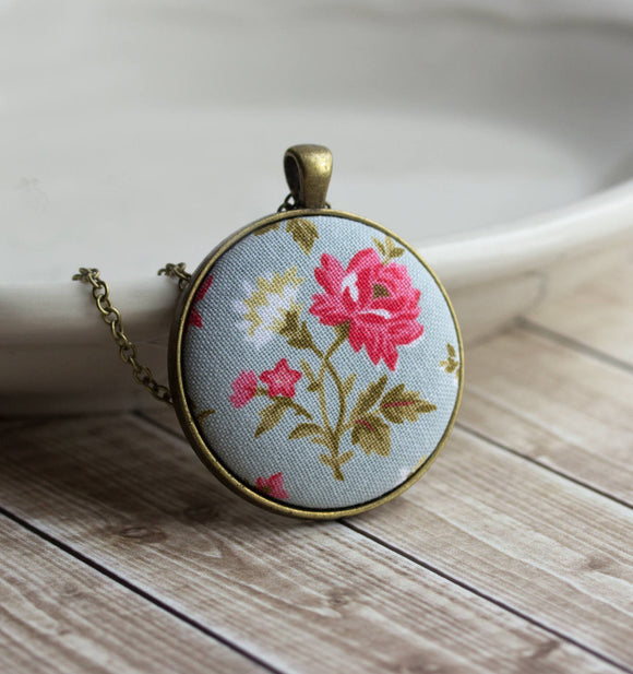 Pink Rose Necklace With Pastel Blue Background