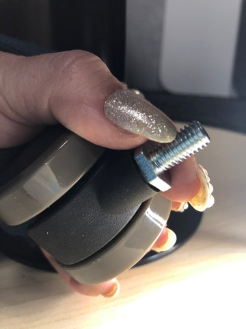 How to hold nut will screwing in caster wheel to base of MojoDesk
