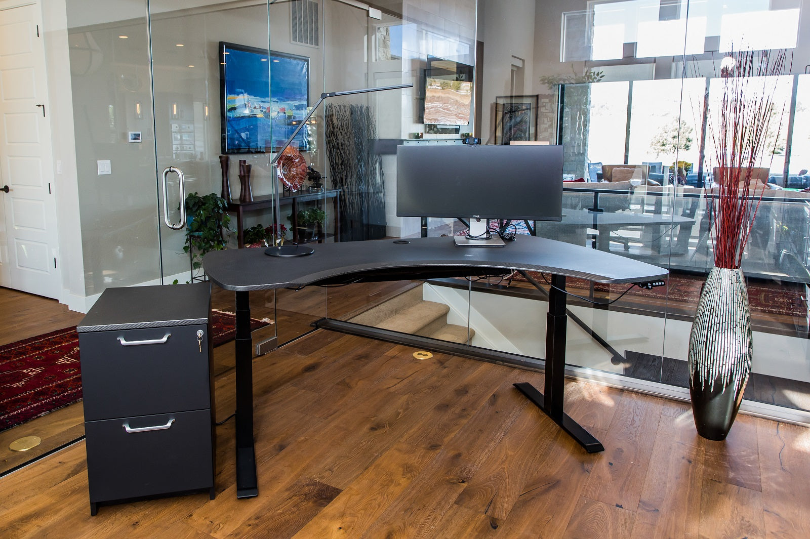 L Shaped Standing Desk shown in glass office