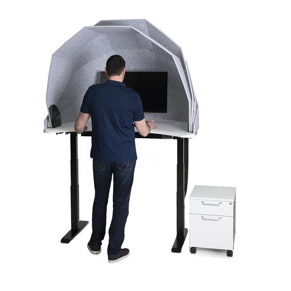 MojoDome man standing in front of standing desk pod
