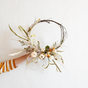 Dried flower wreath with white and orange blooms